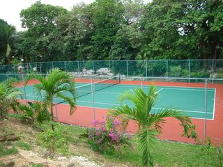 Playa del Carmen house photo - Community tennis court - located behind the house