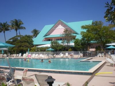 Beautiful large heated pool with restaurant and Tiki Bar in background