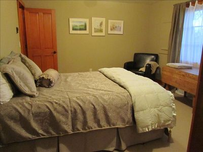 "The ""green"" bedroom: excellent bedding (including down comforter), queen bed."