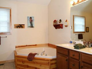 Branson cabin photo - Full bathrooms with 2 person whirlpool tubs, double vanities and walk in shower.