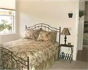 Queen bed in guest room with private bath