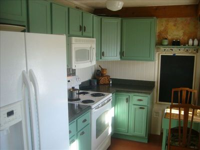 Kitchen with Stove, Fridge, Dishwasher, and All Utensils