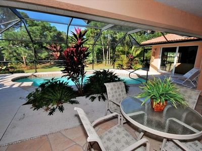 Swimming pool and lanai with live tropical plants. Privacy and serenity.
