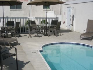 Wildwood Crest condo photo - Large private heated pool and patio with bath facilities