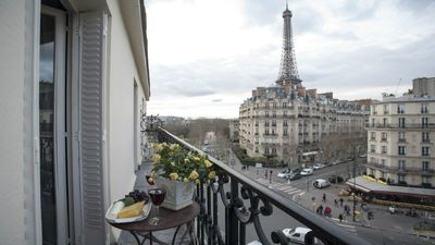 Dine al fresco on your balcony with stunning Eiffel views