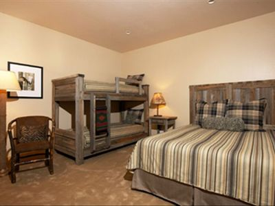 Guest bedroom suite queen, double bunk,  reading chair, plush carpet