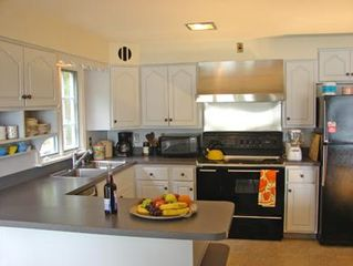 Orleans house photo - Modern, light filled eat-in kitchen with double oven, griddle and water views