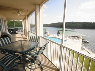 Osage Beach condo photo - The Expansive Deck Overlooks the Pool and Lake with seating for 10 and Gas Grill