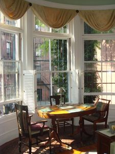 Dining area adjacent to lovely bay windows