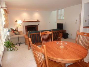 Dining Area and Living Area and access to deck overlooking 13th fairway.