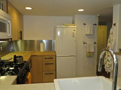 European-style refrigerator and freezer. Washer and dryer also included.