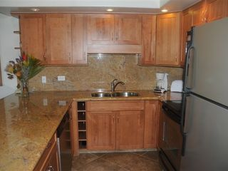 Kaanapali condo photo - Newly remodeled gourmet kitchen with granite & wine rack