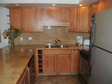 Newly remodeled gourmet kitchen with granite & wine rack