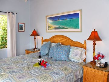 The romantic master bedroom has A/C, a king bed, islandy decor, and en suite BR