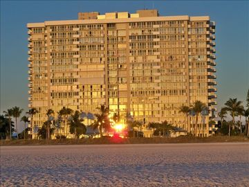 View of the Admiralty House Condo from the beach at sunset