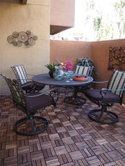 Old Town Scottsdale condo photo - Outside dining area with beautiful Acacia wood tiles on the patio.