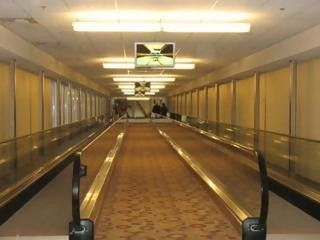 Two hotels are connected via an internal air conditioned moving walkway