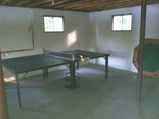 Barnstead house photo - Ping pong table. And that's a poker table standing on end, at the ready!
