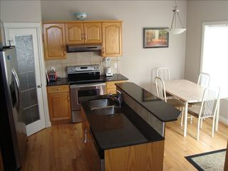 Calgary house photo - Calgary Vacation Home convection oven, large fridge, ice maker, filtered water