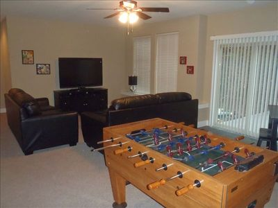 Downstairs you will find Xbox, Foosball, games and more with access to patio