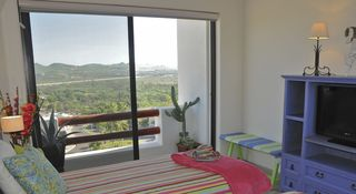 San Jose del Cabo condo photo - BR4: Twin or King set-up; slider view of estuary and sea + 2nd picture window.