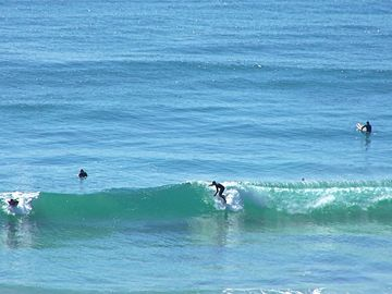 Surfers at Daba Strand Beach