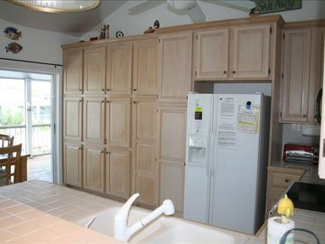 Completely Stocked Kitchen with a built in Bar Cabinet for your Happy Hour.