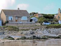 BEACH COTTAGE, pet friendly, with a garden in Sandend, Ref 12172