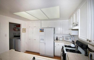 Open Kitchen. Refrigerator w/ filtered water and ice and a Separate Laundry Room