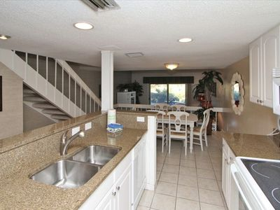 Lovely open White Kitchen with Granite counter tops ugraded appliances!