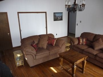 Great room with love seat and queen size sofa bed
