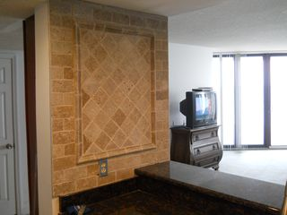 Garden City Beach condo photo - Tile accent wall in kitchen