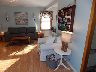 Harbor Beach cottage photo - Relaxing and Reading Area in Living Room. Book Rack.