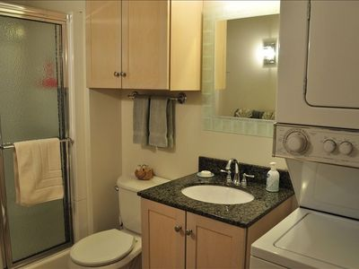 Bathroom with washer/dryer and walk-in shower