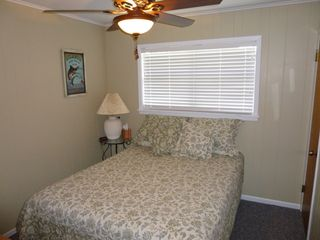 Brenham estate photo - Smaller upstairs bedroom (queen bed)