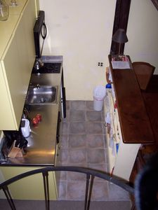 Looking west: down over kitchenette from spiral stair