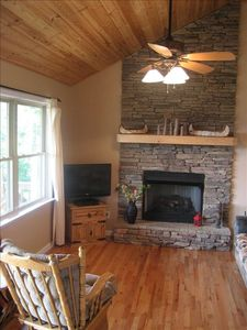 Stack-stone Gas Fireplace, View from Living Room, 15-Ft Wood Ceilings
