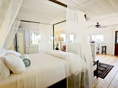Inside view of James Cottage, warm, soft lighting and egyptian cotton sheets.