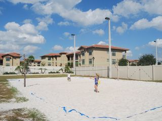 Regal Palms condo photo - beach volleyball area can be found near the pool & tiki bar.
