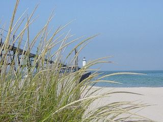 Manistee condo photo - Lighthouse and Pier at the Beach