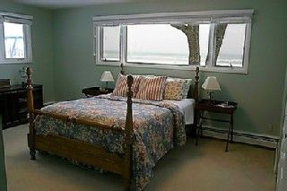 Oscoda house photo - Master Bedroom. Views of the lake. King bed and master bathroom.