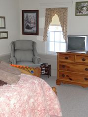 North Conway house photo - Queen bedroom chair and small TV