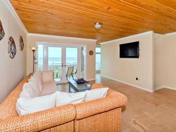 Great Room with tastefull pine ceiling and flat screen wall mounted TV