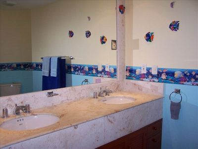 Large Bathroom With Stone Countertops