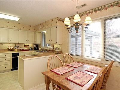 The Updated Kitchen Offers a Comfortable Breakfast Area.