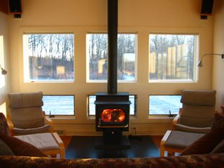 New Glarus house photo - In winter, enjoy the wood stove while lying on the over-sized couch