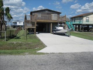 Rockport house photo - View of front of home owners boat in drive way