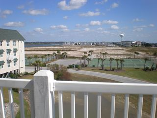 Ocean Isle Beach condo photo - Island view and tennis courts just steps away