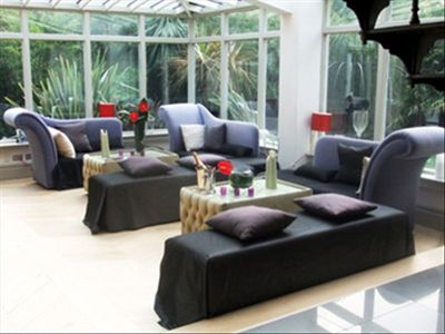 The conservatory is a bright and relaxed space with views onto the exotic garden