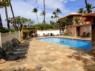 Kihei condo photo - Upper pool with tables, chairs, loungers & barbeques (lower pool has free WiFi).